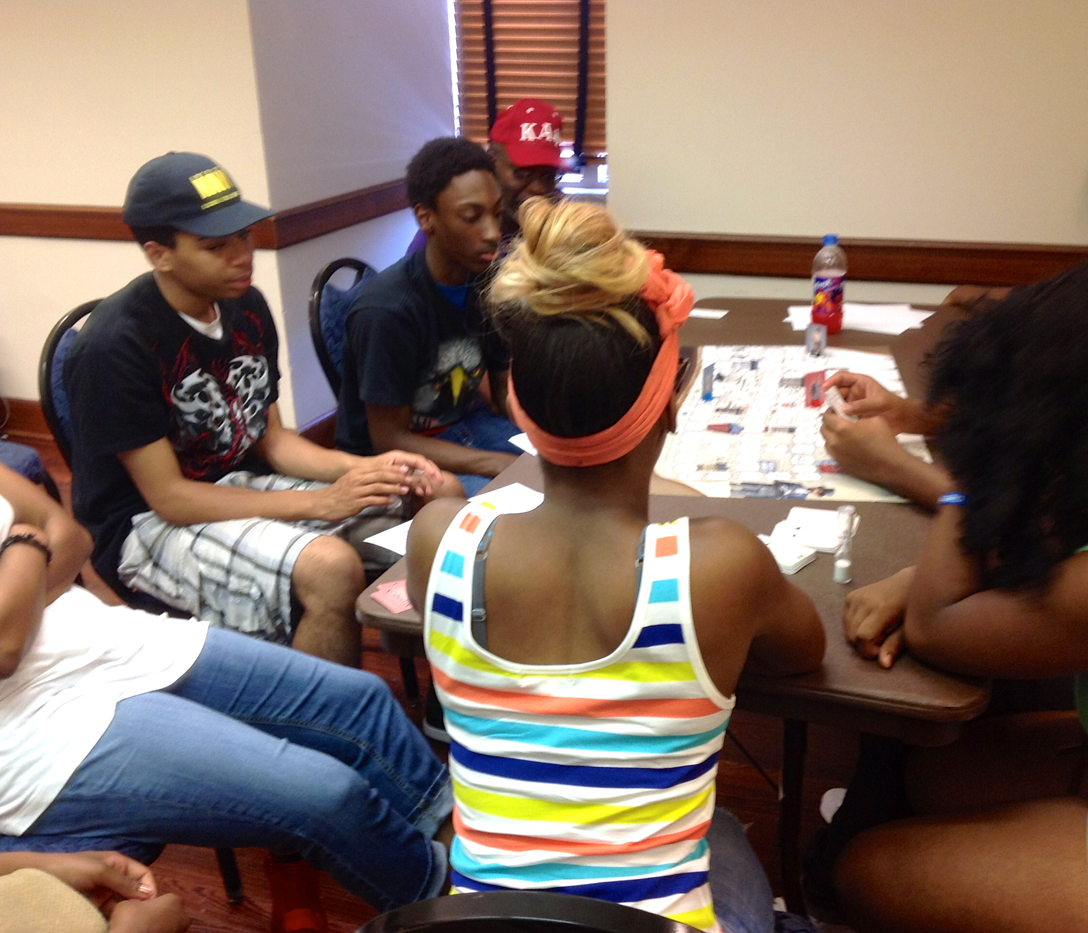 High school students from Homewood, Pittsburgh playing The Ward board game.