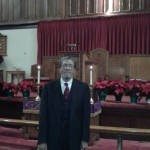 Rev. Frank Tyson in front of pulpit